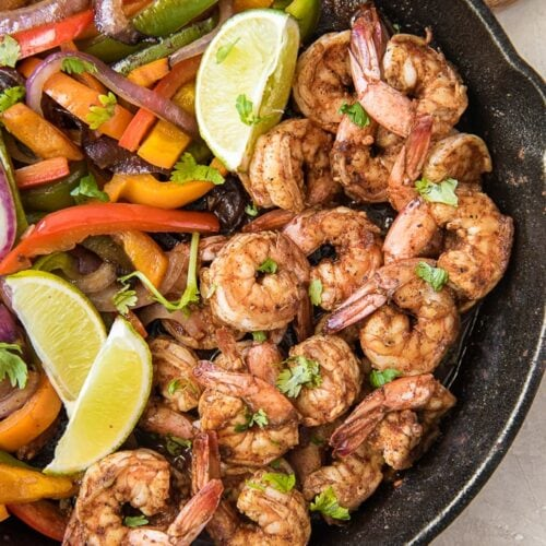 Social media image of pan filled with shrimp and peppers and onions