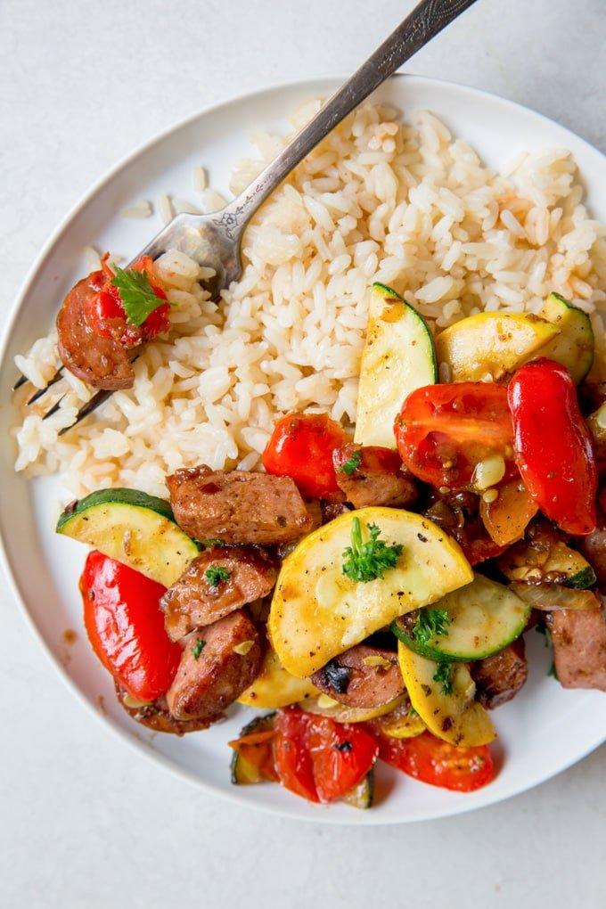 A plate of Rice, Sausage and Zucchini