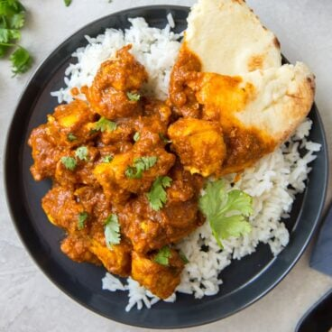 Social media image of chicken curry and rice on a plate