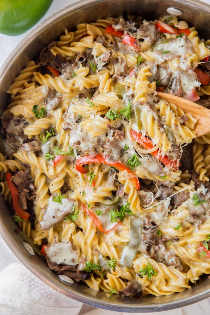 Philly Cheesesteak Pasta one pan dish with a wooden spoon in it