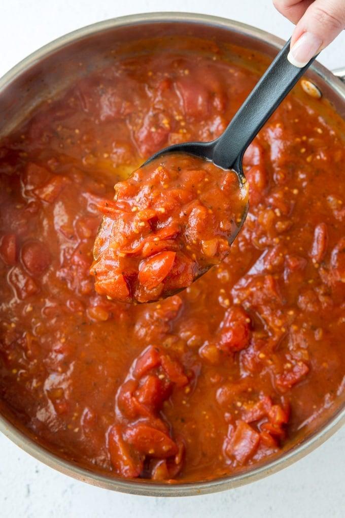 A pan filled with marinara sauce