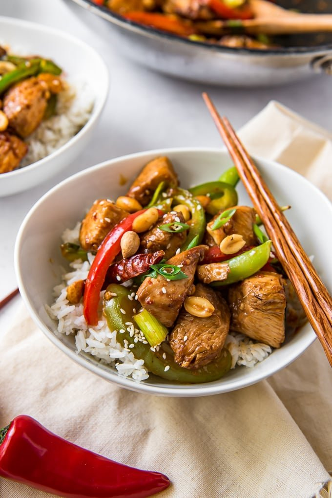 30-Minute Szechuan Chicken Stir Fry in a bowl with rice