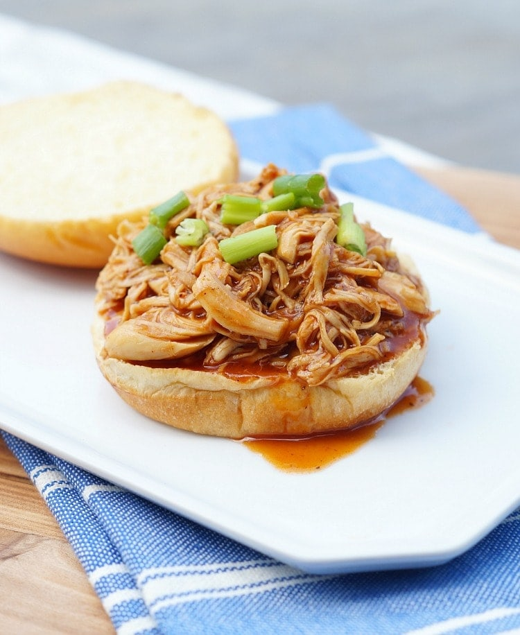 shredded bbq chicken piled on a mini slider bun.