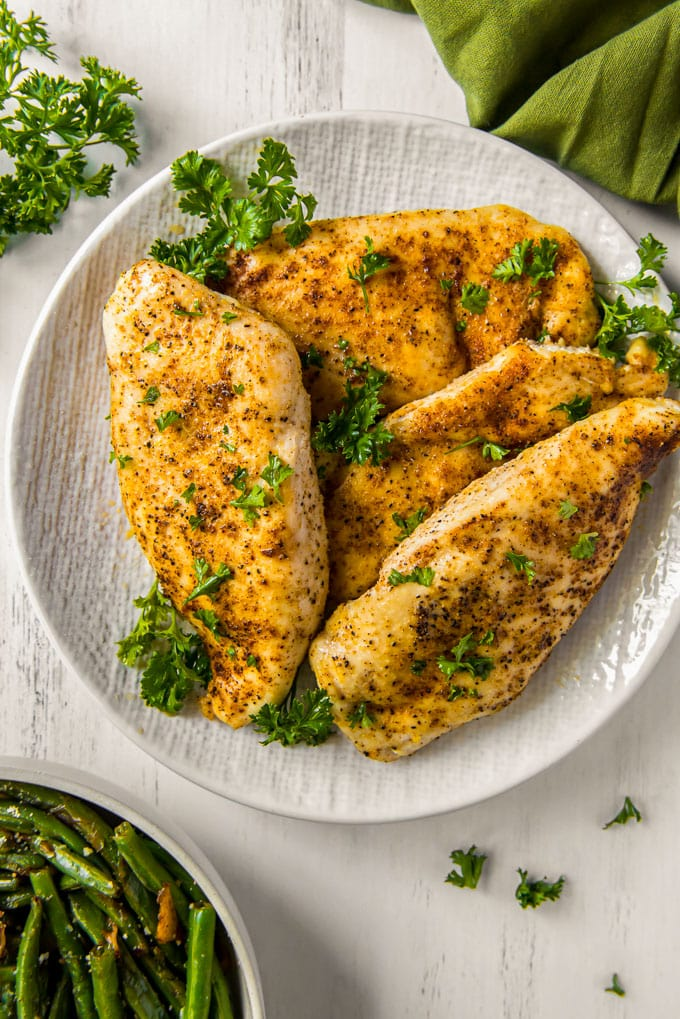 chicken breasts on a white platter