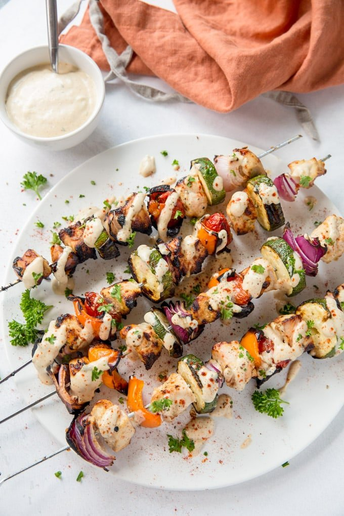 Chicken and vegetables on skewers and coated in garlic lime dressing.
