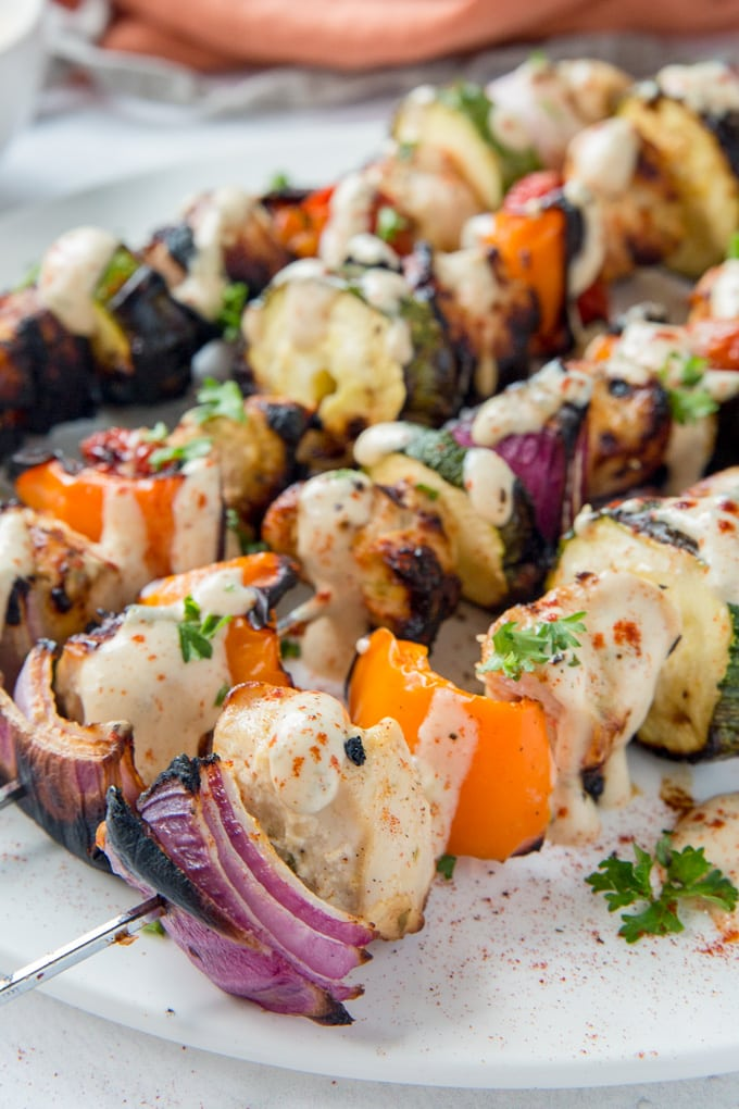 A close up of chicken and veggie skewers