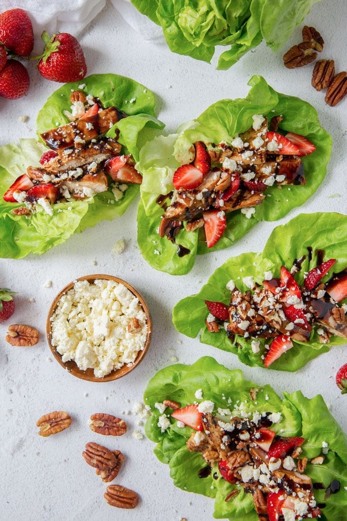 4 lettuce wraps with balsamic chicken, feta cheese and pecans