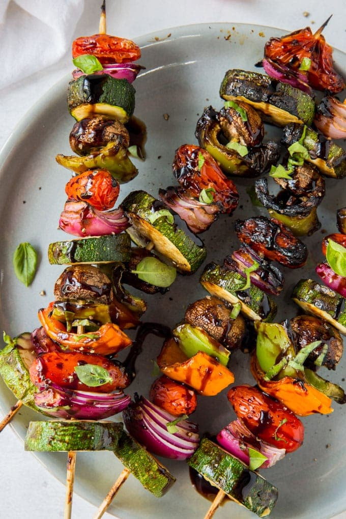 Overhead close up of vegetables threaded on skewers that have been grilled
