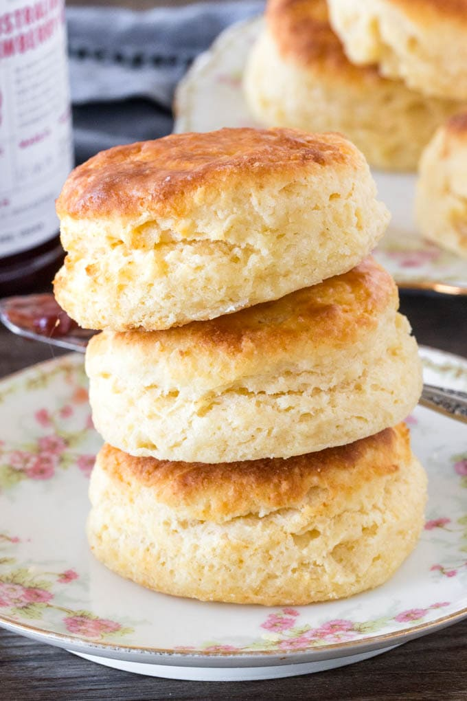 A stack of 3 homemade biscuits shot from the side to show the height of each biscuit.