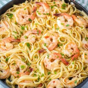 Shrimp Scampi is a classic dish loaded with garlic, butter, and sweet shrimp cooked to perfection. Serve over pasta for a quick and easy dinner you'll love!