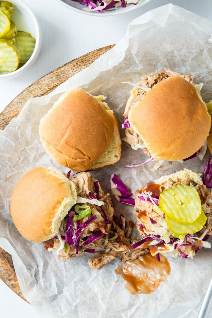 Pulled pork on slider buns topped with coleslaw and pickles