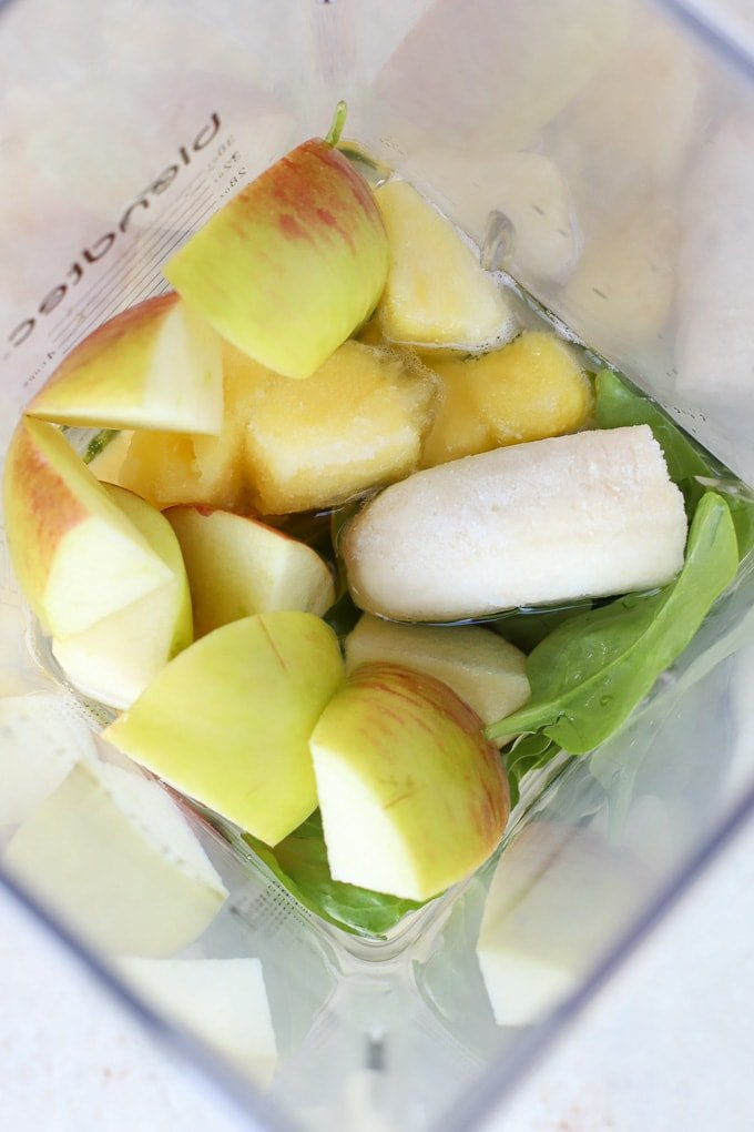 Apple, pineapple, banana and spinach in a blender.