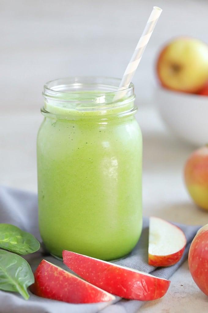 A green smoothie in a mason jar.