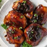bbq baked chicken thighs image created for social media