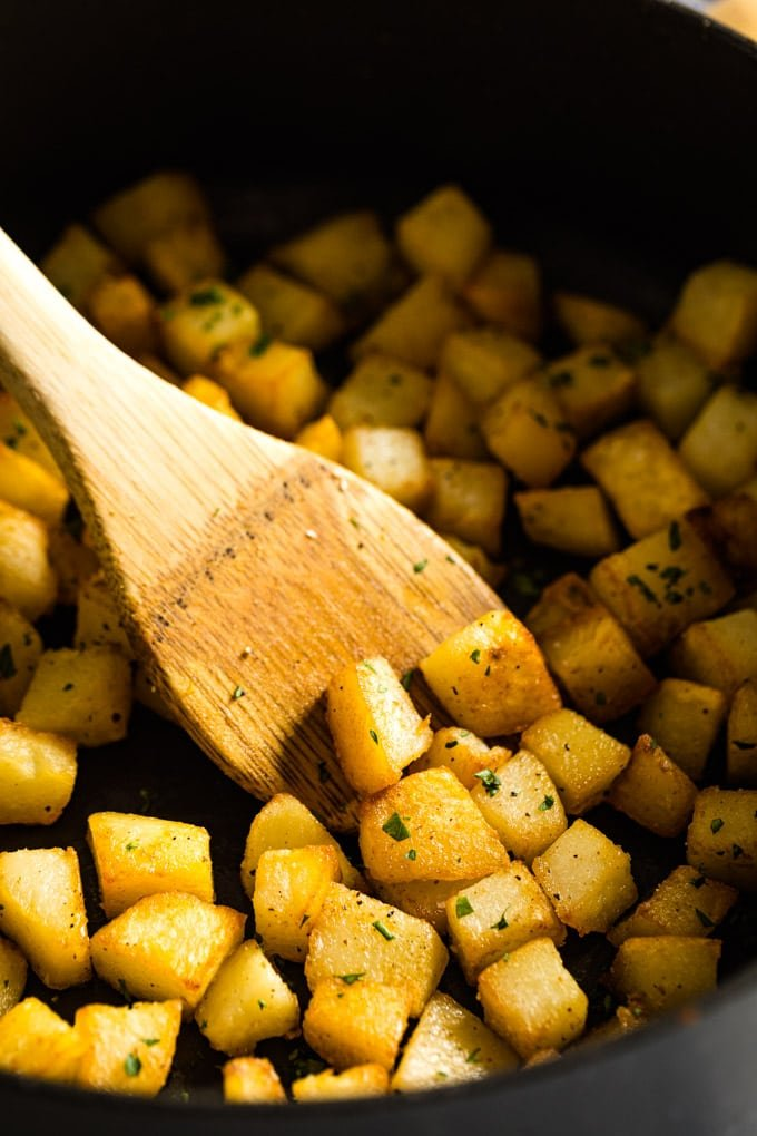 Skillet potatoes in a pan.