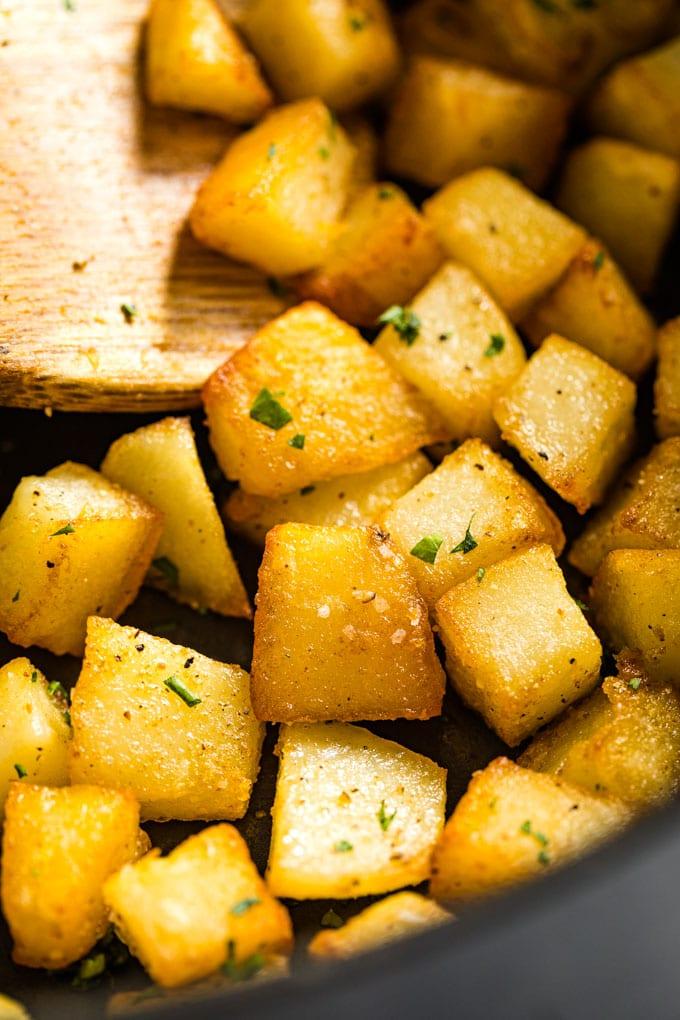 A close up of crispy skillet potates.