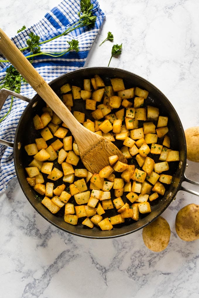 An overhead shot of skillet potatoes in a skillet.