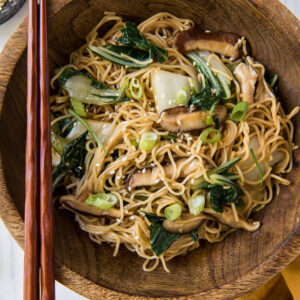A bowl of noodles and vegetables