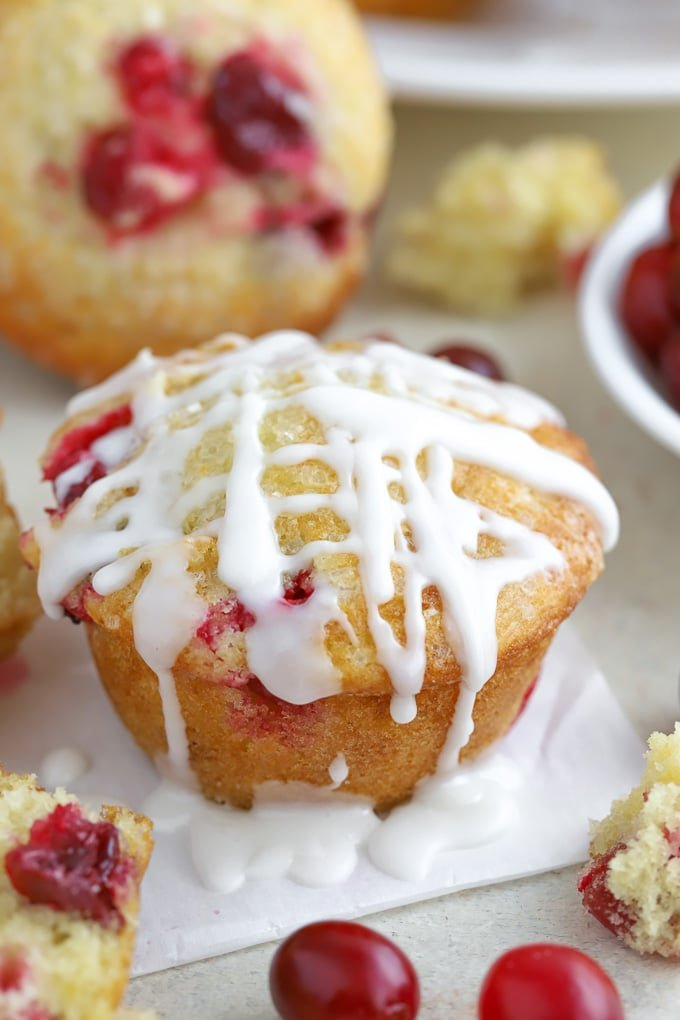 Cranberry Muffin drizzled with powdered sugar glaze.