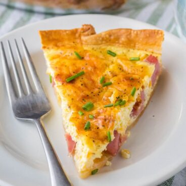 Ham and Cheese Quiche recipe is my go-to for brunch or holiday breakfast with the family. Incredibly easy to make and always a hit at breakfast!