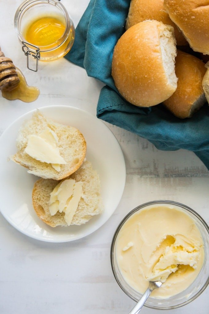 A plate of rolls with Butter