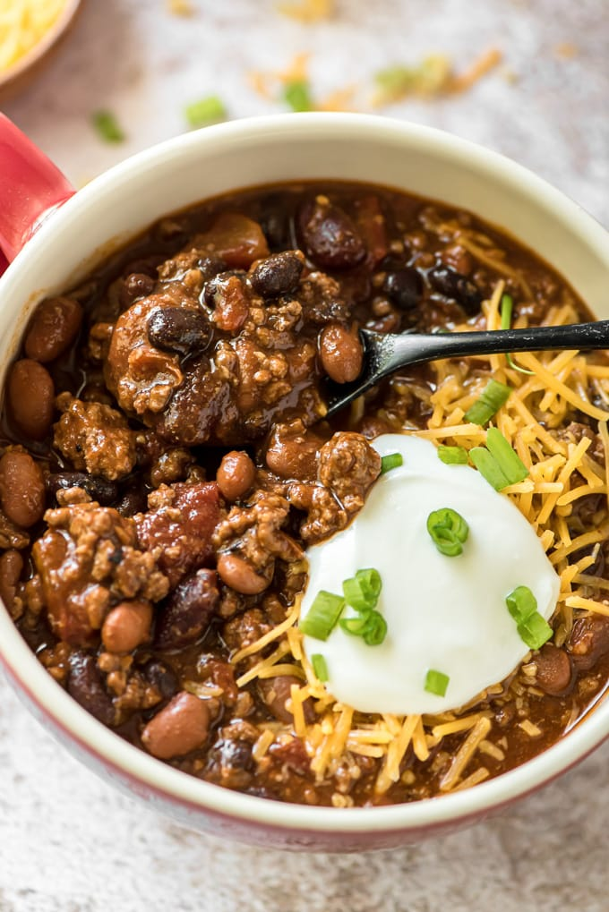 A spoonful of chili in the bowl