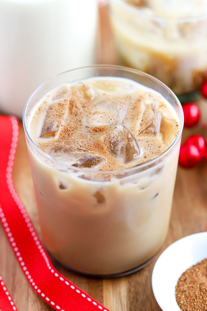 Eggnog White Russian Cocktail in an ice-filled glass topped with ground nutmeg.