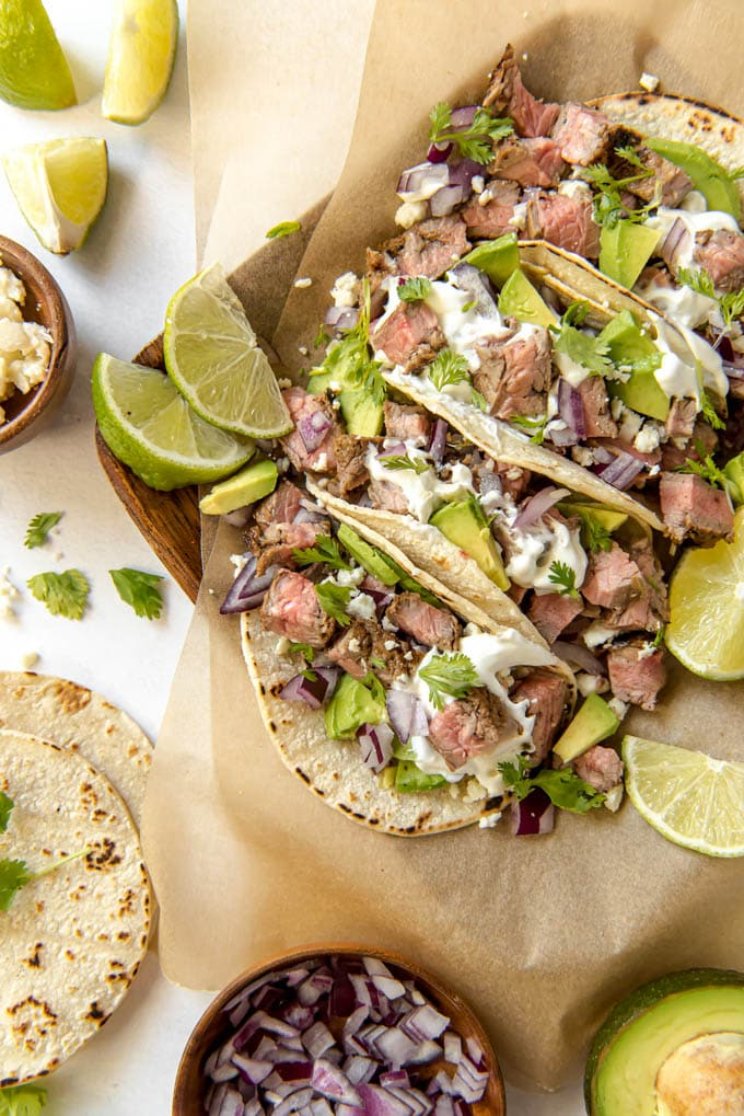 street tacos filled with skirt steak, avocado and other toppings