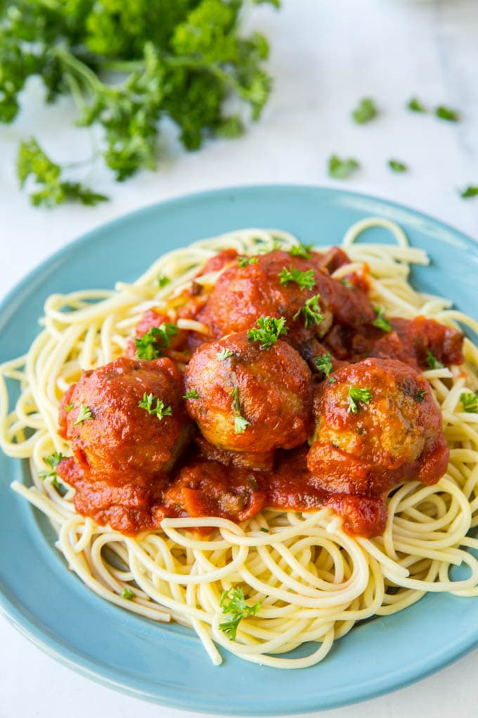 serving chicken meatballs with pasta and sauce