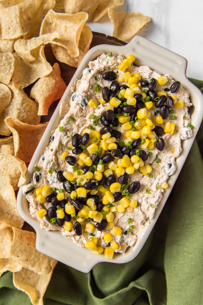 overhead shot of black bean and corn creamy dip and tortilla chips