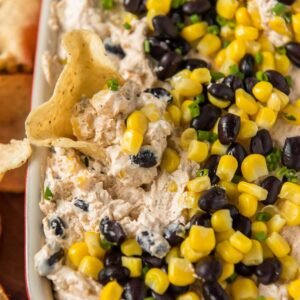A close up of southwest dip with beans and corn