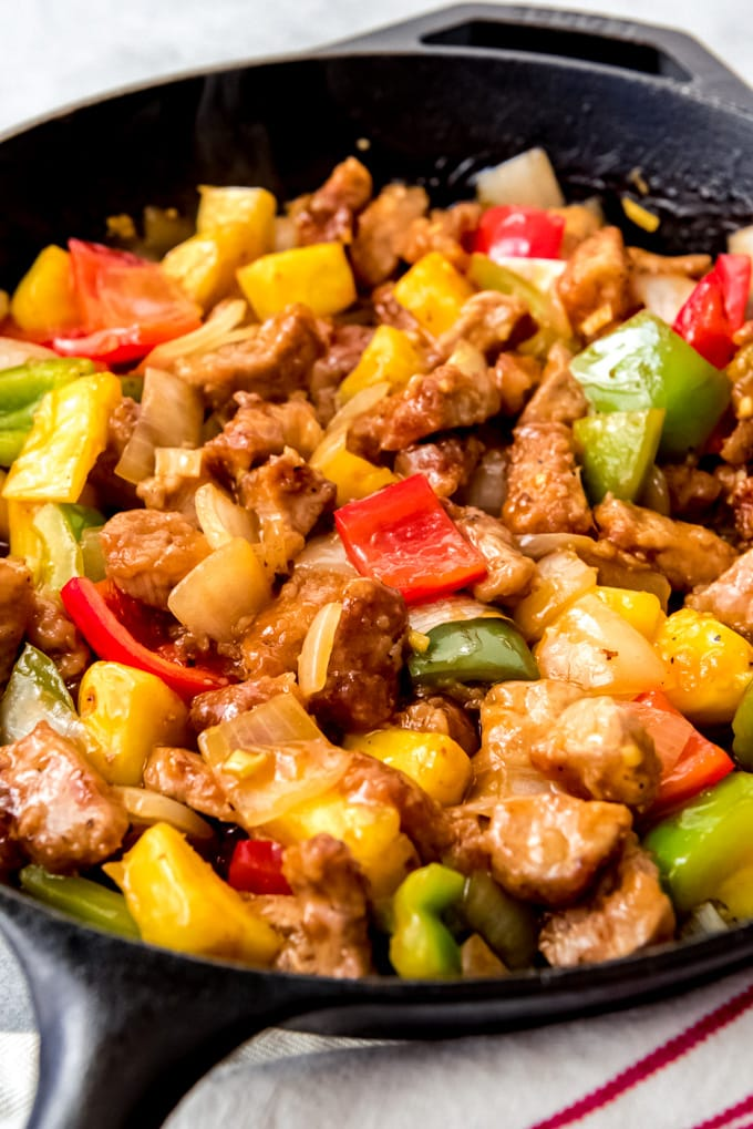 An image of homemade sweet & sour pork in a large pan.