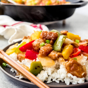 A dish filled sweet and sour pork with rice