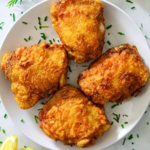 A plate of fried chicken thighs