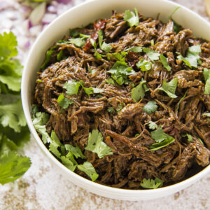 A bowl of shredded Barbacoa Beef