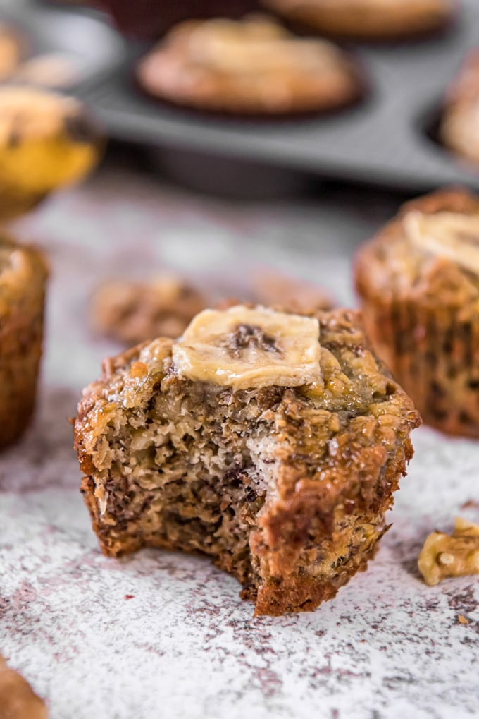 A banana bran muffin with a bite taken out of it.