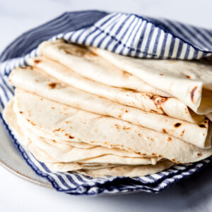 Flour Tortillas wrapped in a blue striped towel