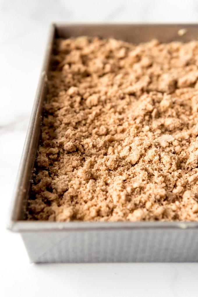 An image of cinnamon crumb cake in a pan.