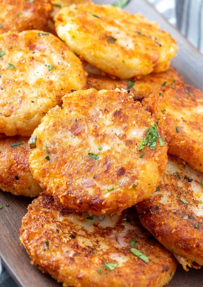 a close up of a stack of potato croquettes