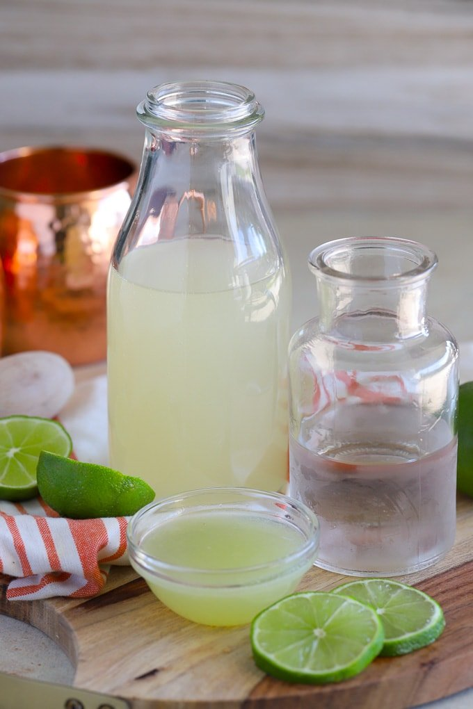 Ingredients for Moscow Mule - ginger beer, vodka, lime juice.
