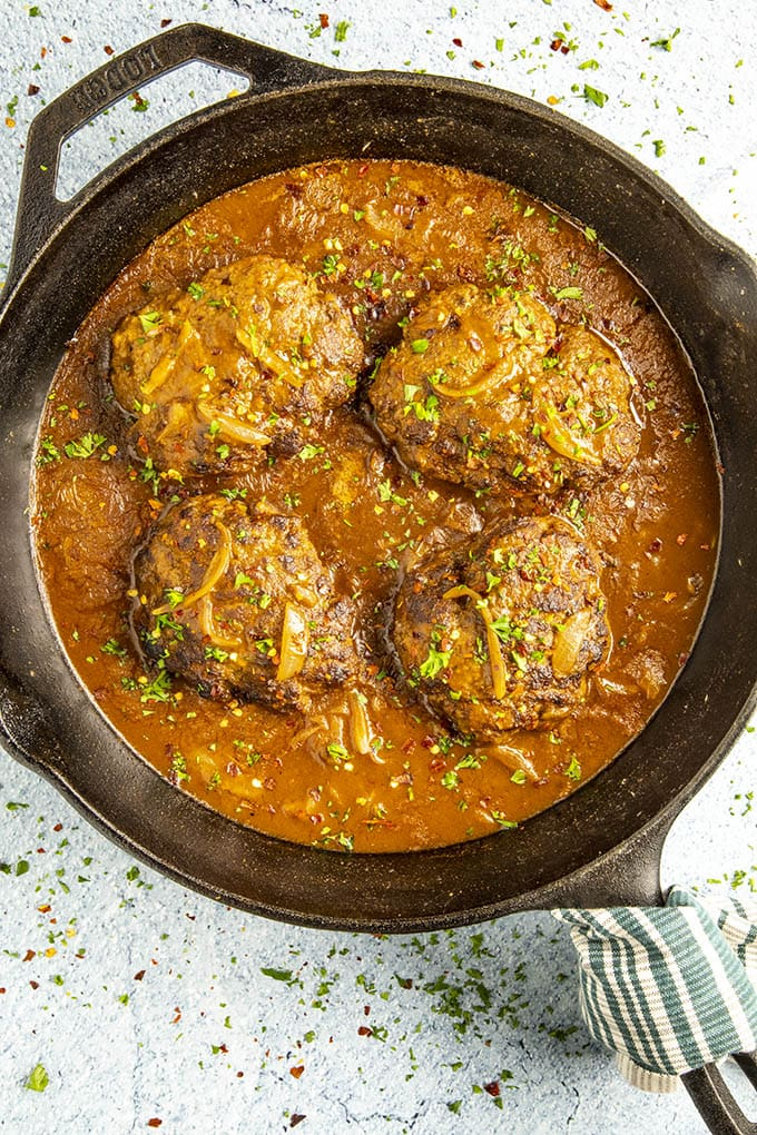 Salisbury Steaks smothered with ancho gravy, ready to serve