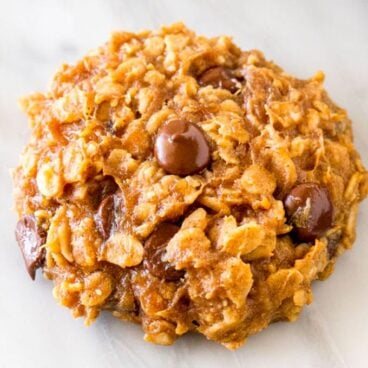 A cookie filled with oats and chocolate chips.