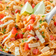 A bowl of taco pasta with chicken and tomato