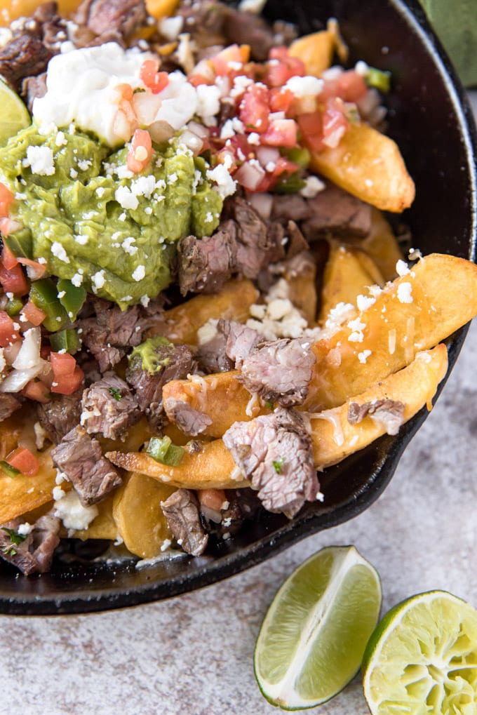steak fries loaded with carne asada, pico and guacamole and cheese