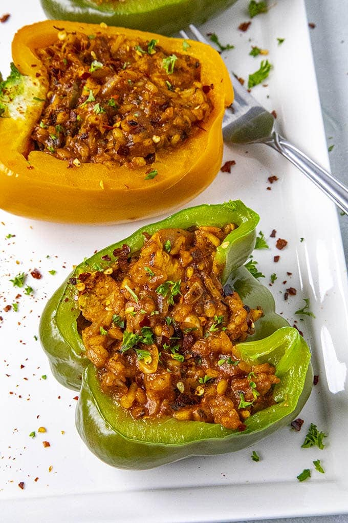 Chicken and Rice Stuffed Peppers close up on a platter with a fork
