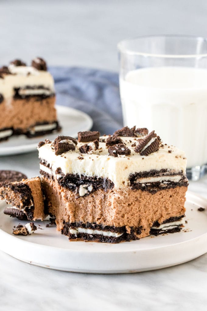Slice Oreo Icebox cake with a bite taken out of it.