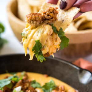 A chip loaded with queso and chorizo.