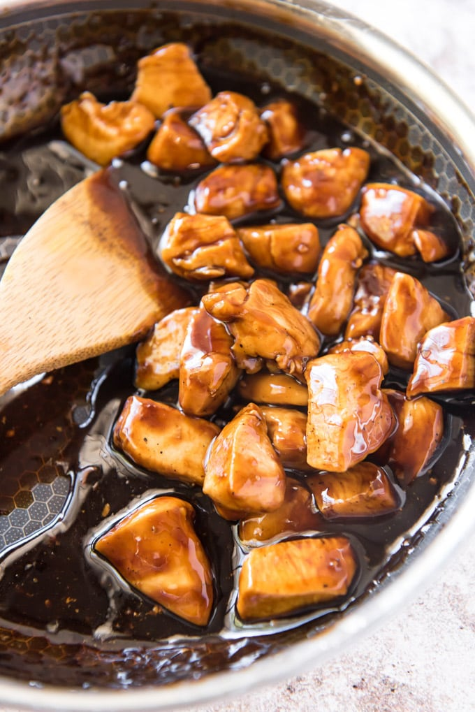 a skillet with chicken chunks in teriyaki sauce