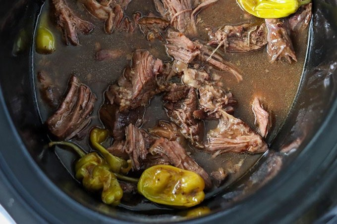 overhead shot of mississippi pot roast in the slow cooker