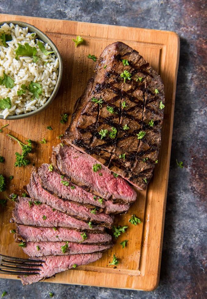 Grilled London broil steak, sliced.
